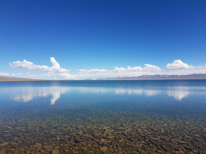 Amazing clear and calm water of Song Kul. Three day horse-riding trip to Song Kul, Kyrgyzstan.
