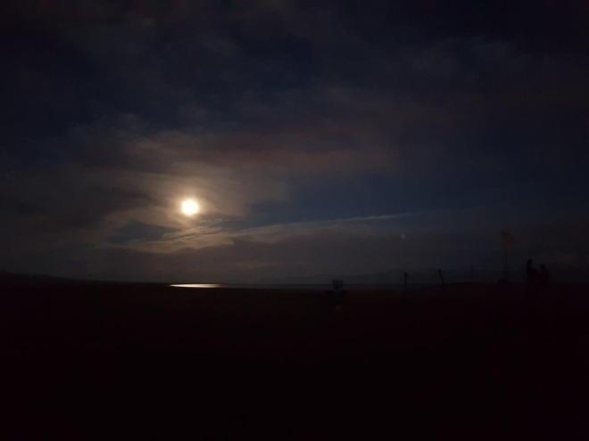 Full moon reflecting in Song Kul. Three day horse-riding trip to Song Kul, Kyrgyzstan.