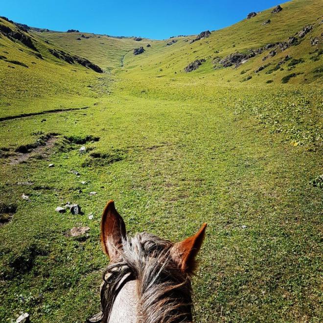 Heading towards WiFi Mountain. Three day horse-riding trip to Song Kul, Kyrgyzstan.