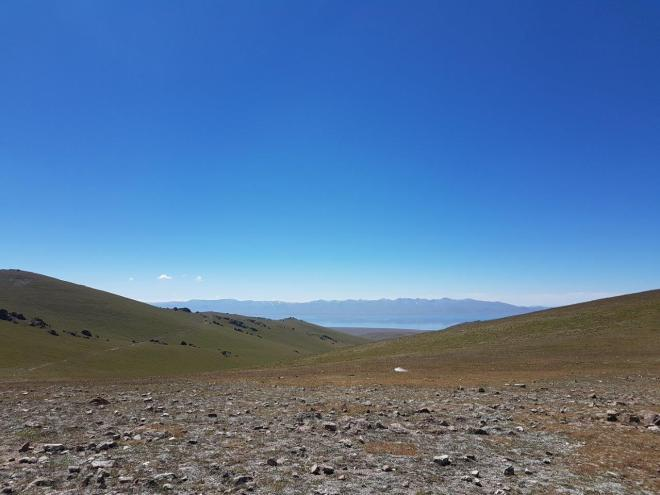 View of Song Kul from the top of the mountain. Three day horse-riding trip to Song Kul, Kyrgyzstan.