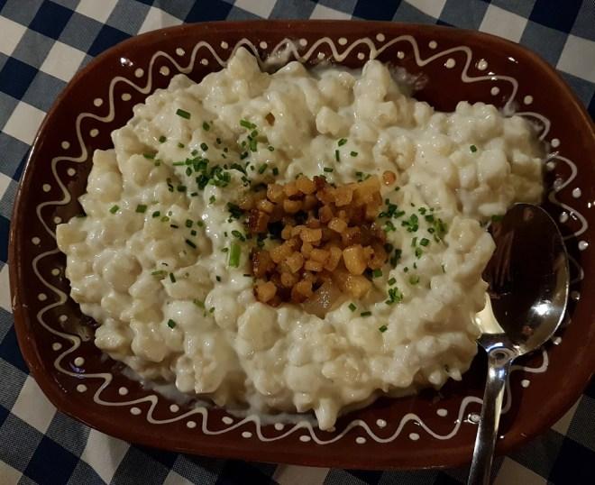 Bryndzové halušky, sheep-cheese dumplings with bacon, that is also the Slovak national dish. Flagship Bratislavská reštauracia. Food tour in Bratislava, Slovakia.