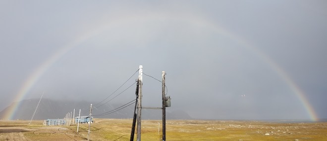 Rainbow at midnight at Isfjord Radio, Svalbard, Norway.