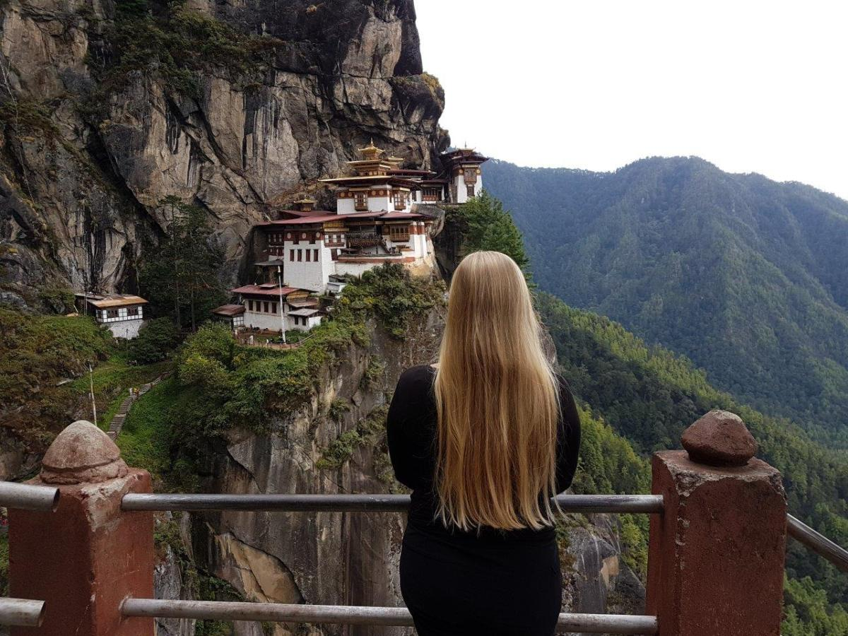 Enjoying the stunning view of Tiger's Nest. Paro Taktsang. Bhutan.