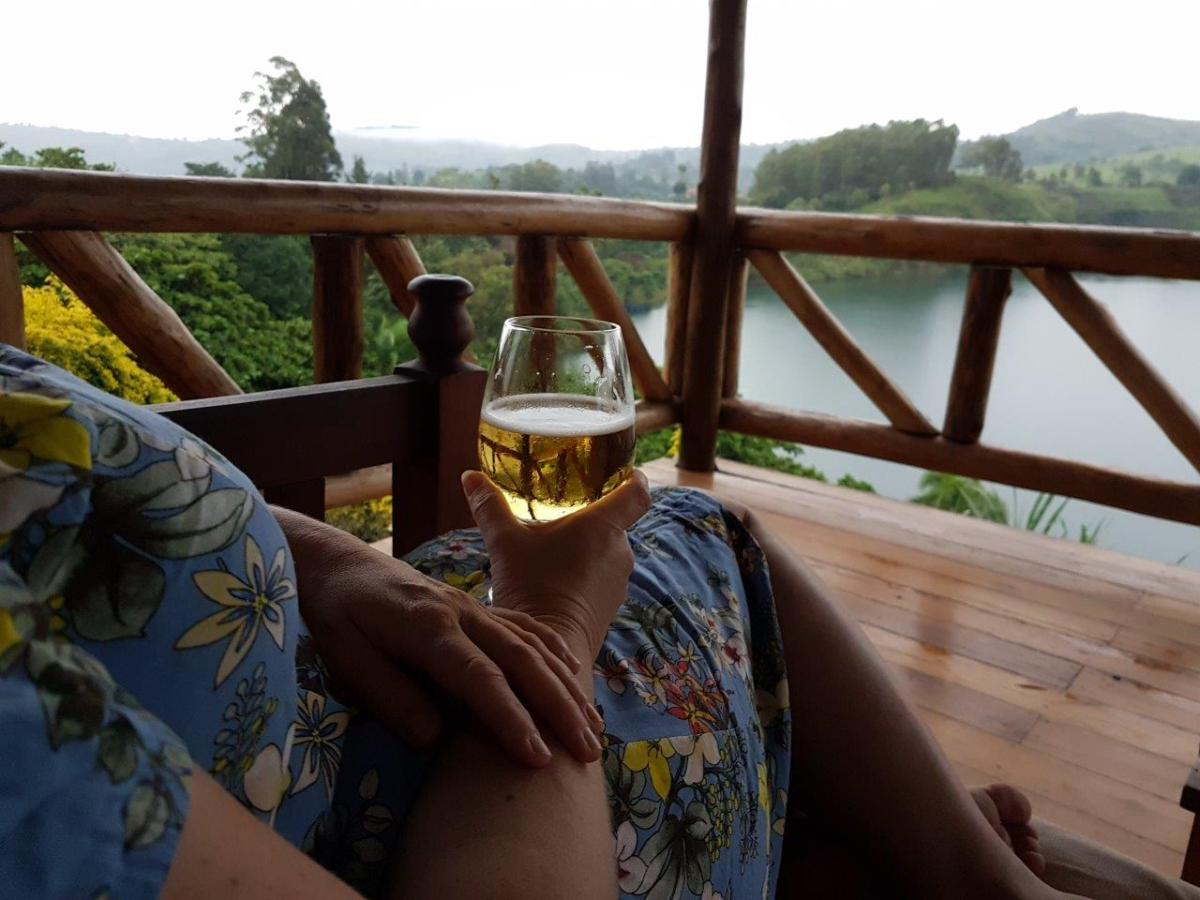 Relaxing with an ice-cold beer at our terrace at Crater Safari Lodge by Kibale Forest National Park, Uganda.