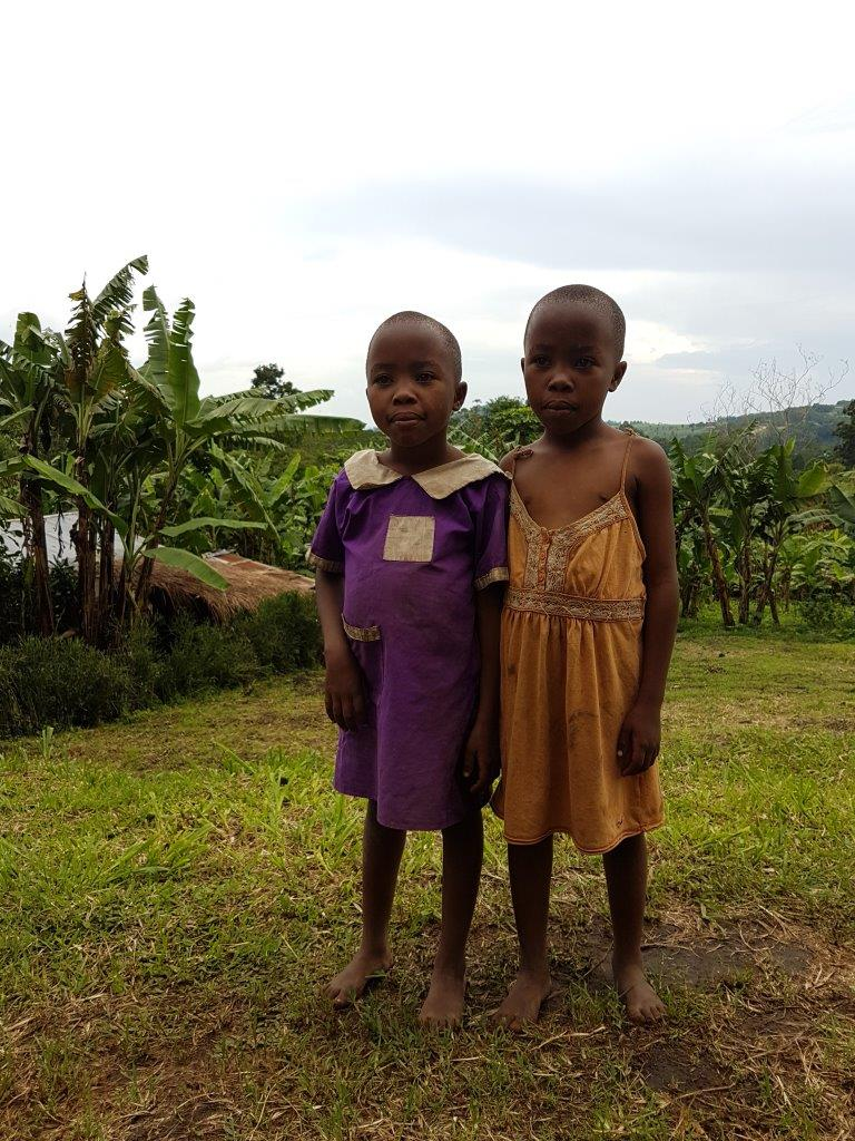 The twins Rachel and Rebecca living in the village near Crater Safari Lodge by Kibale Forest National Park, Uganda.
