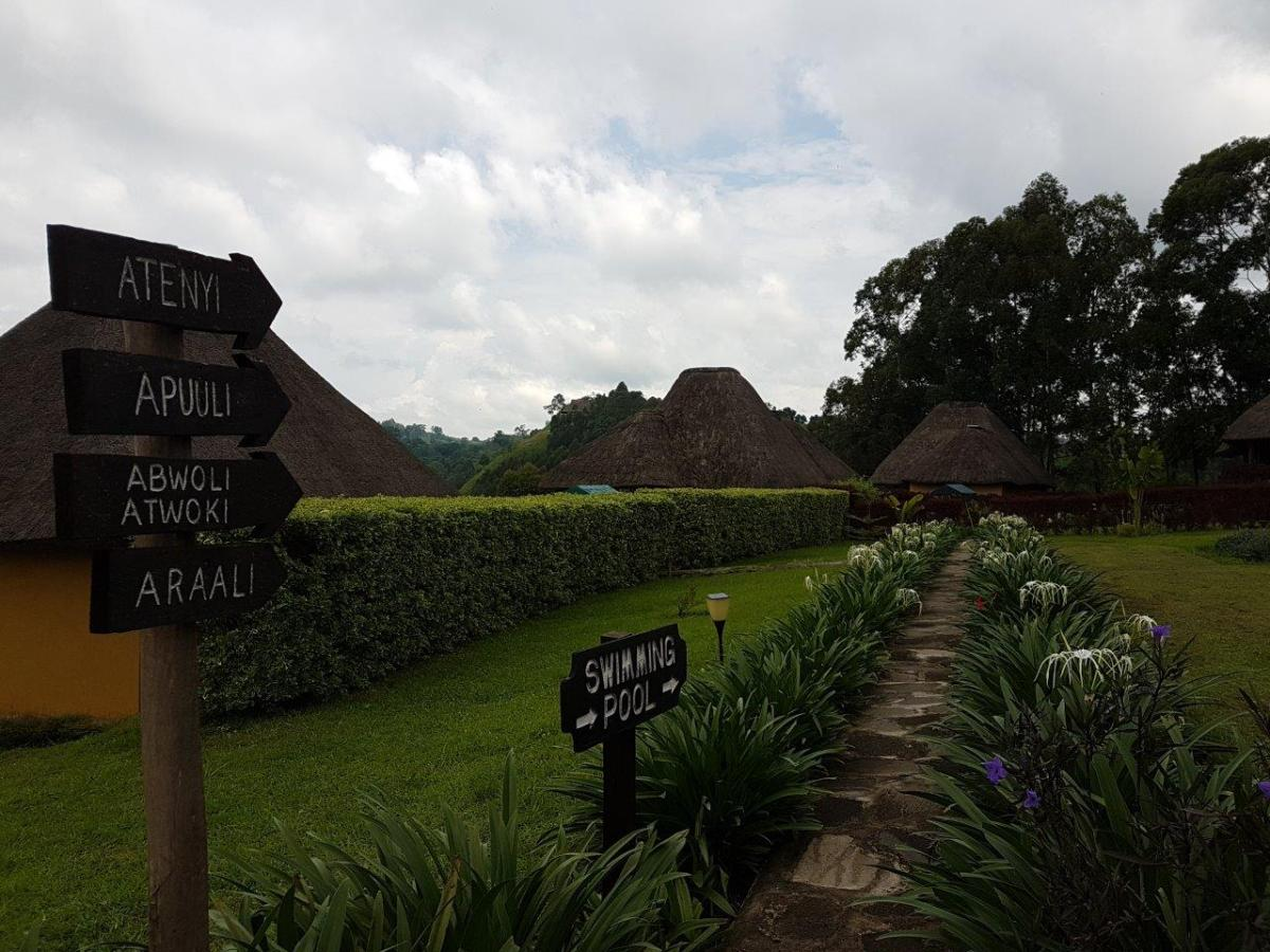 The walk towards the other rooms and swimming pool at Crater Safari Lodge by Kibale Forest National Park, Uganda.