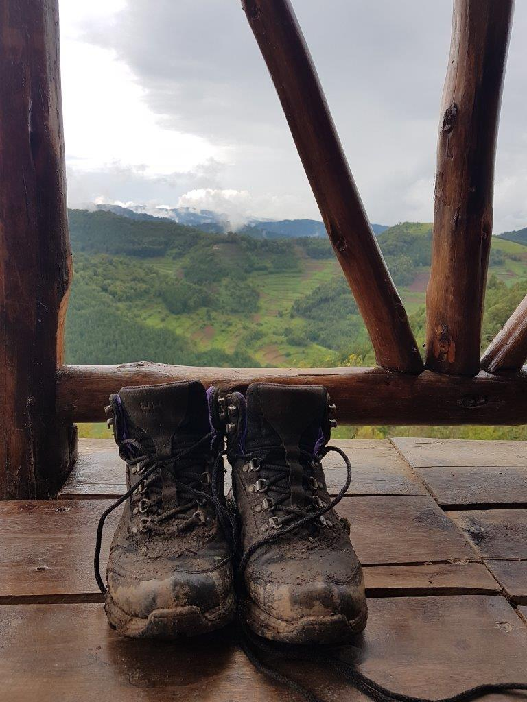 Dirty hiking shoes with a view. Gorilla trekking in Bwindi. Ruhija, Uganda.