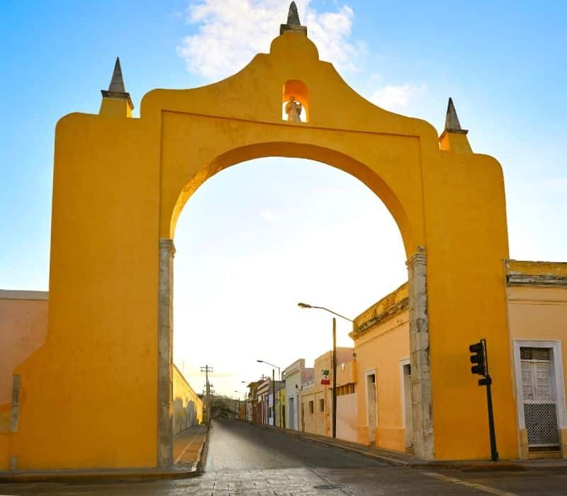 yellow archway on a colonial street