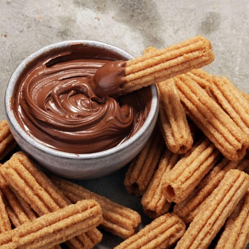 mexico city churros and a chocolate dipping sauce