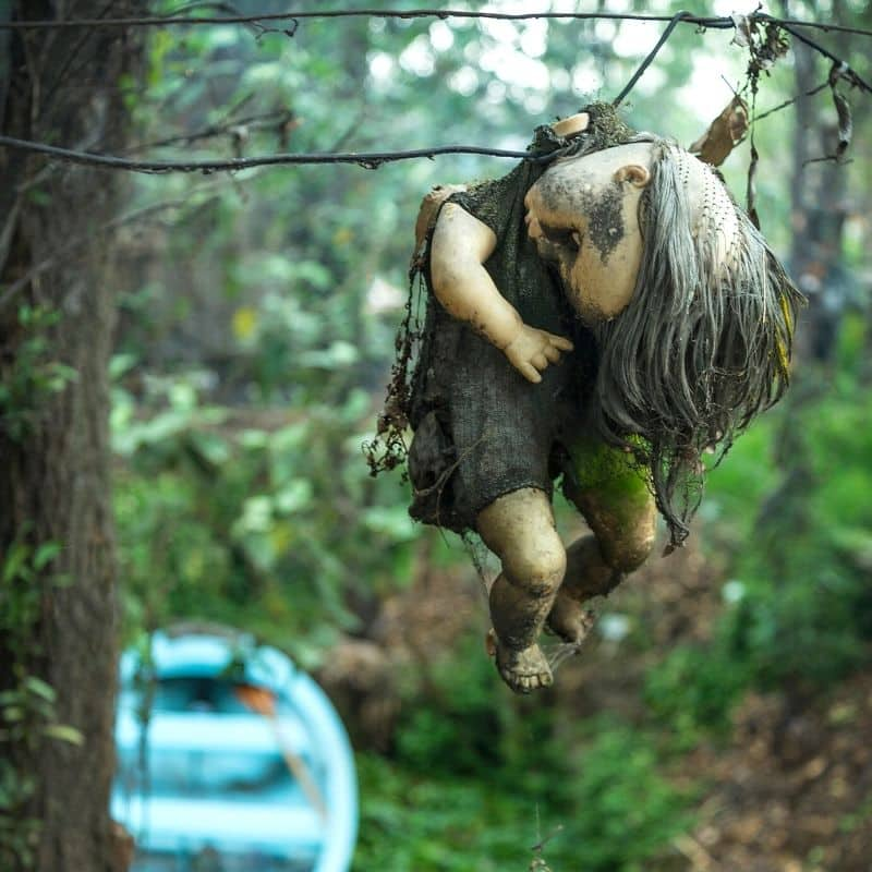 baby doll hanging on a tree at Island of the Dolls