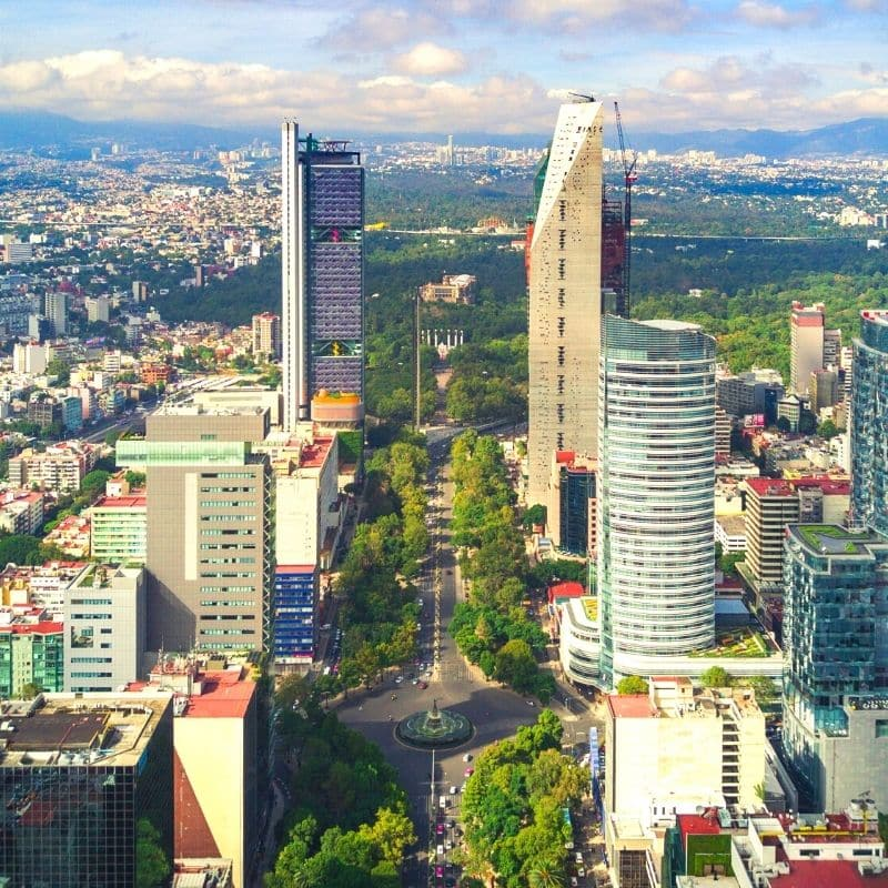 Trees and skyscrapers along Reforma Avenue in Mexico City