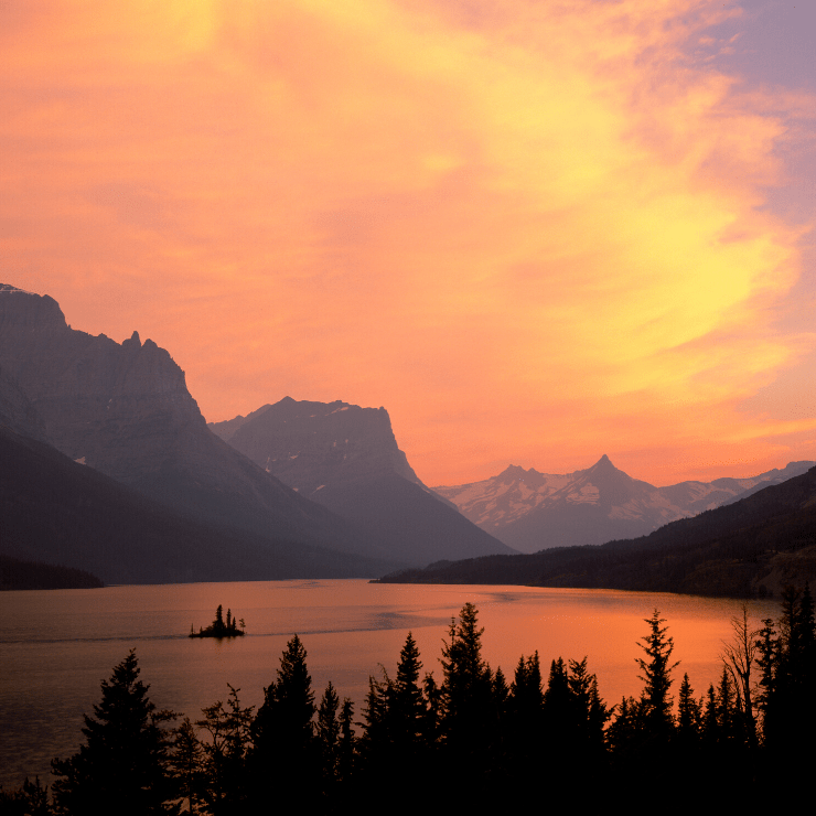 Vibrant Montana sunset over St. Mary Lake in Glacier National Park.