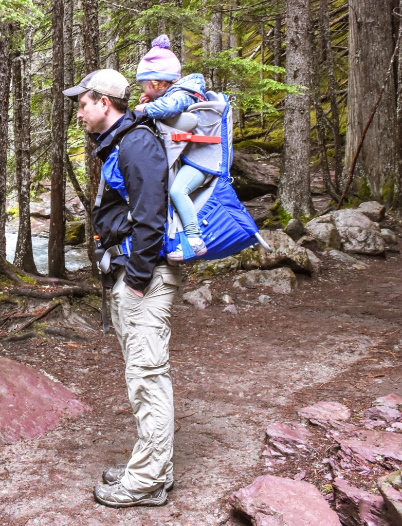 Father and toddler using the Osprey Carrier on a hike in Glacier National Park.