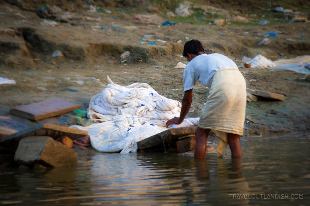 Man does laundry in Ganges River