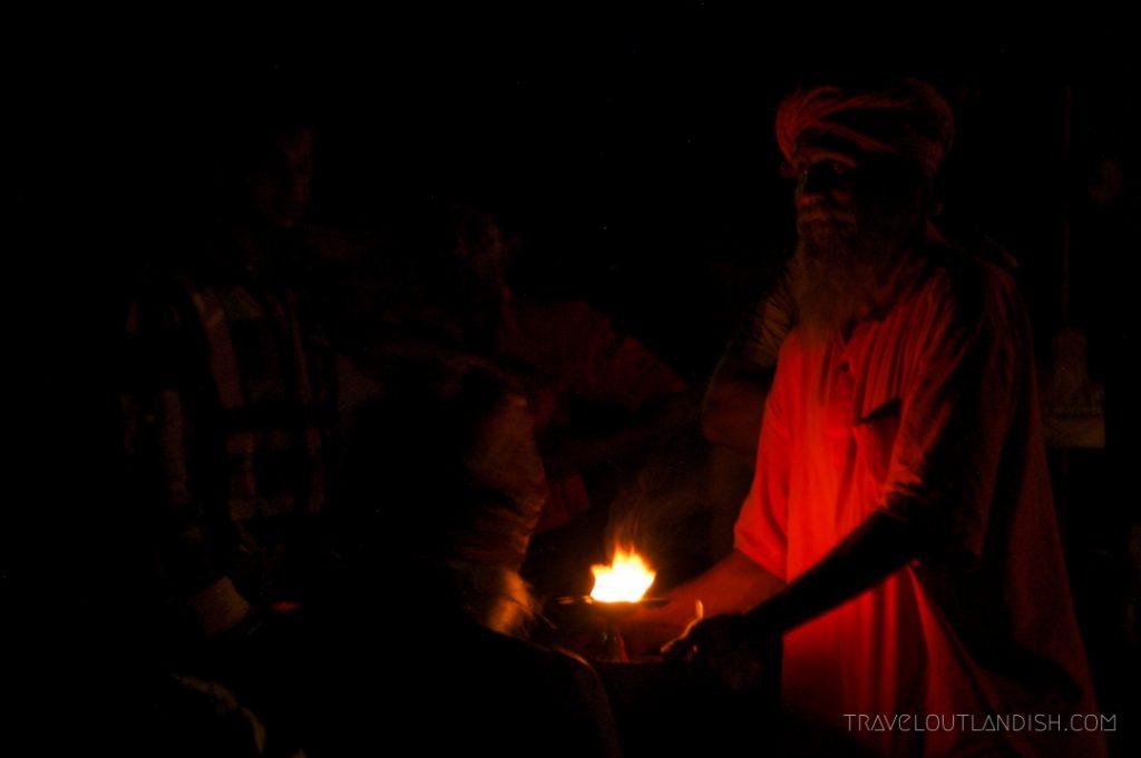 Holy man Varanasi at night