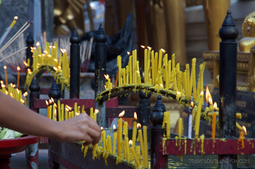 Fun Things to do in Chiang Mai - Yellow Candles melting at Doi Suthep