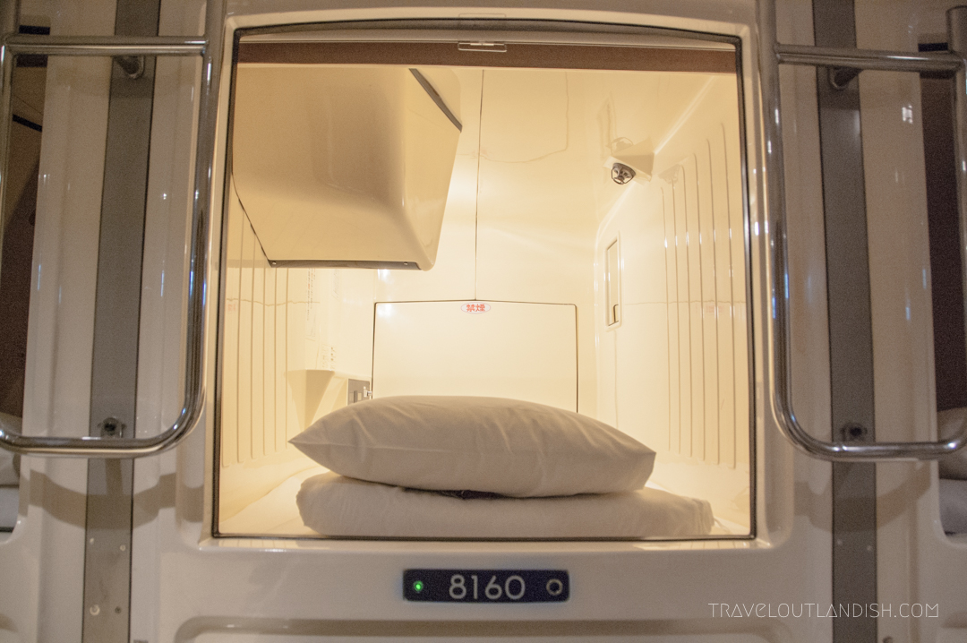 A Single Bed in a Capsule Hotel
