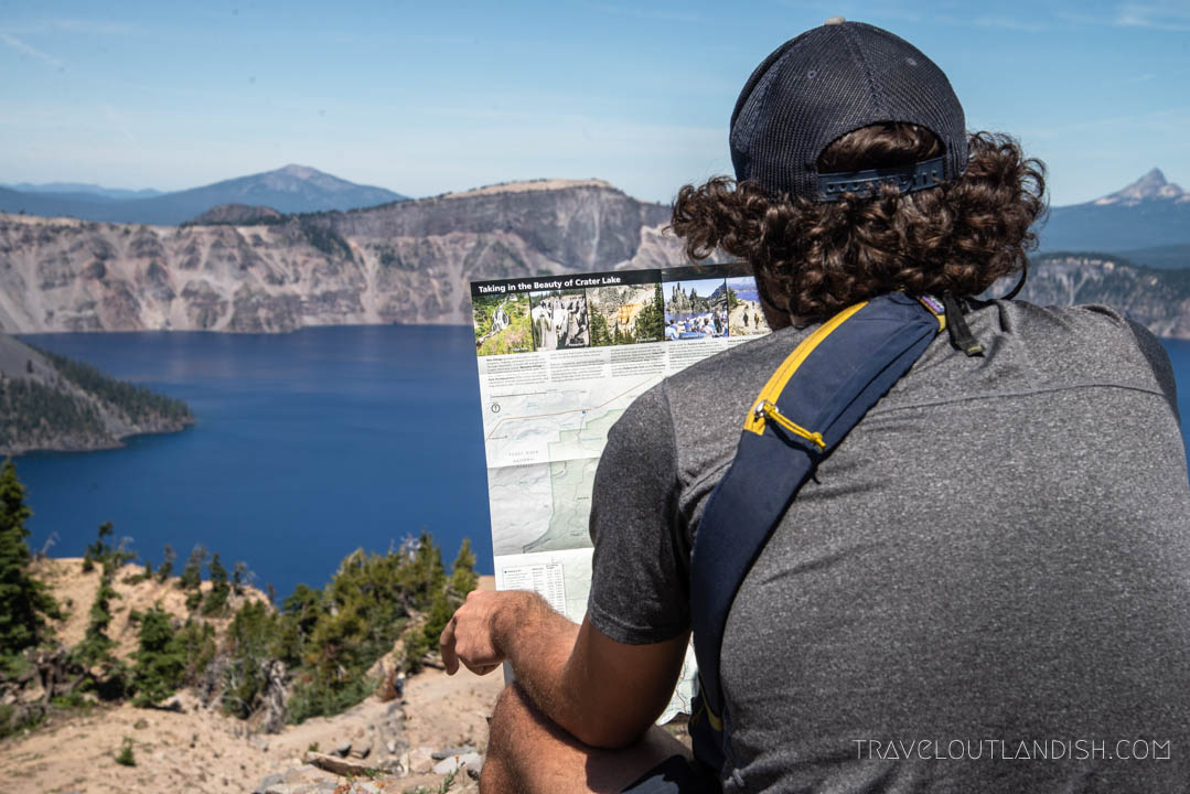 Jake looking at the map for hikes in Crater Lake National Park