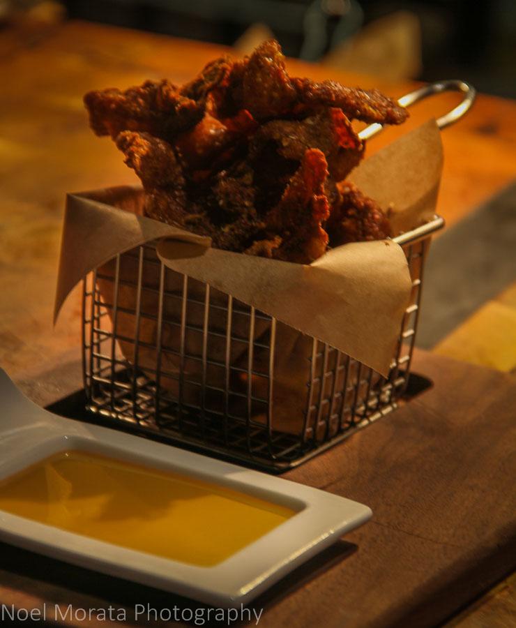 Crispy chicken skins and smoked honey dip