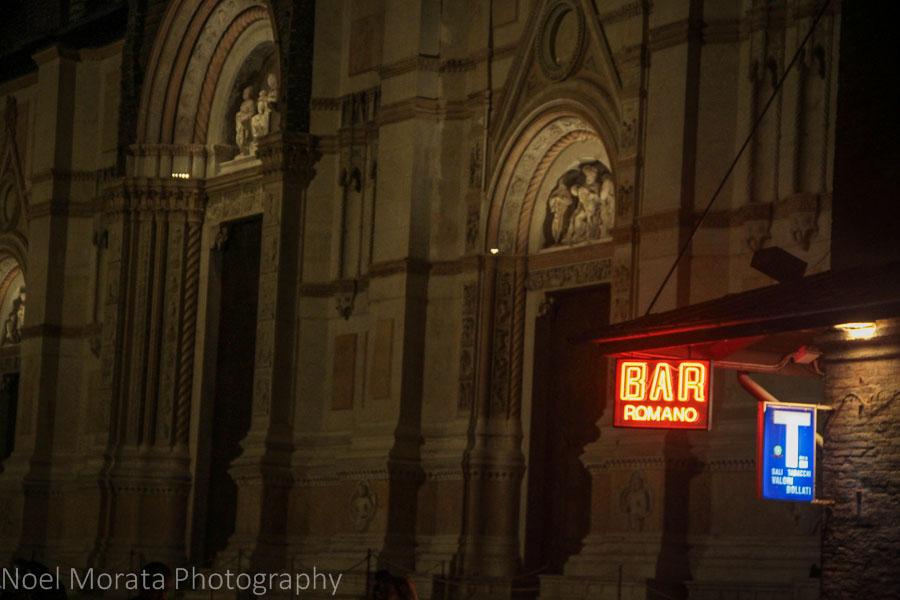 Neon glows next to the Basilca San Petronio