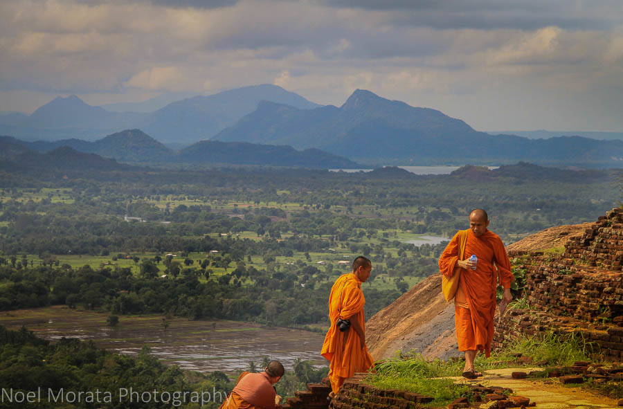 Monks climbing the ruins at Sigiriya in the Golden Triangle