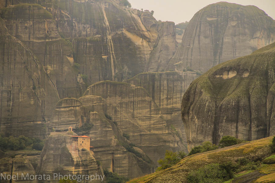A lonely monastery dwarfed by huge mountains in Meteora