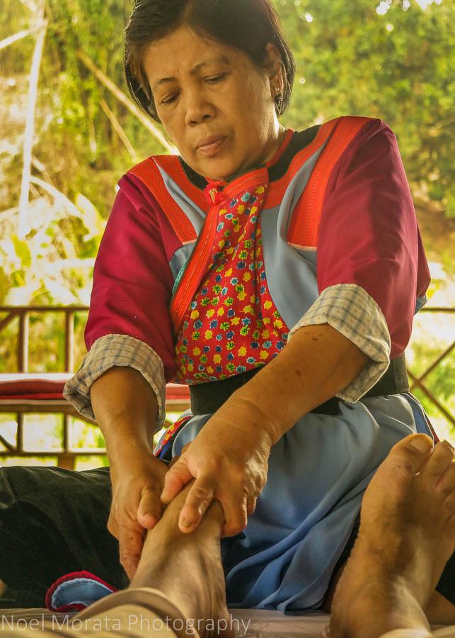 Lisu woman giving a traditional Thai massage