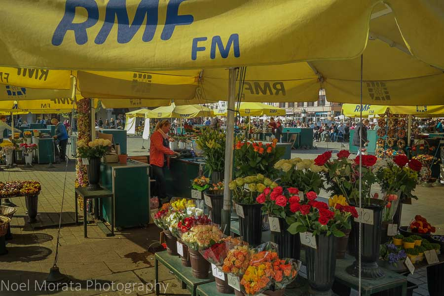 Krakow highlights in one day - flower stalls in the main square of Krakow