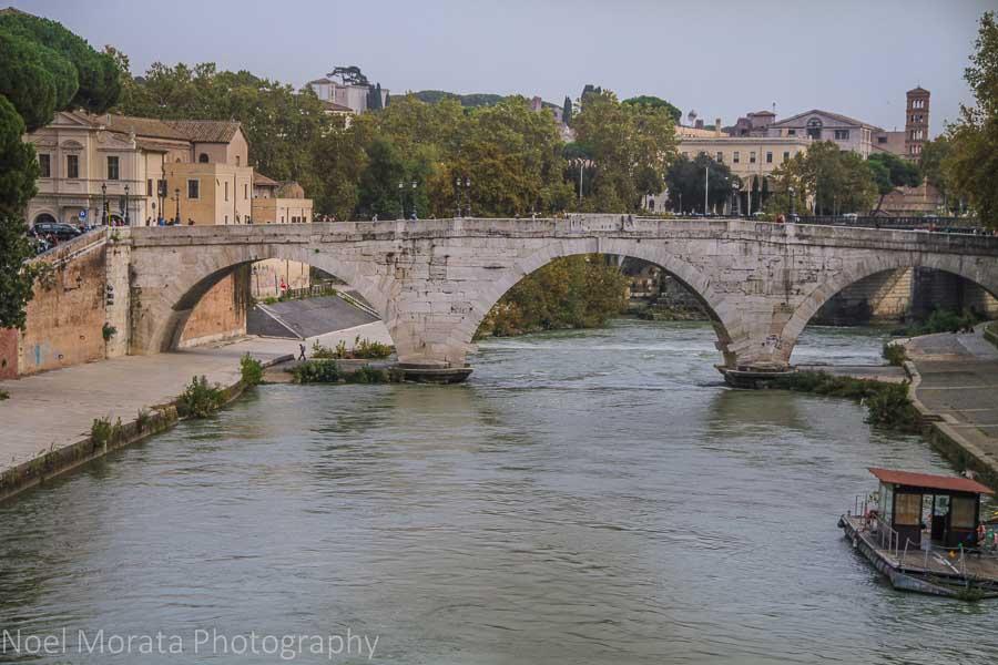 A beautiful stone bridge connecting Isola Tiberina to Trastevere in Rome