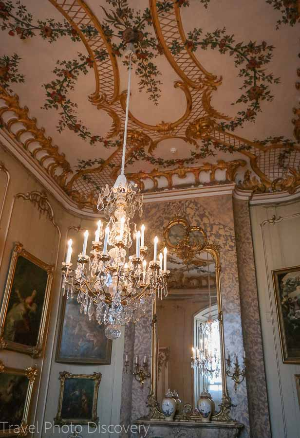 Ceiling Rococo detail and chandeliers at the Neues Palais