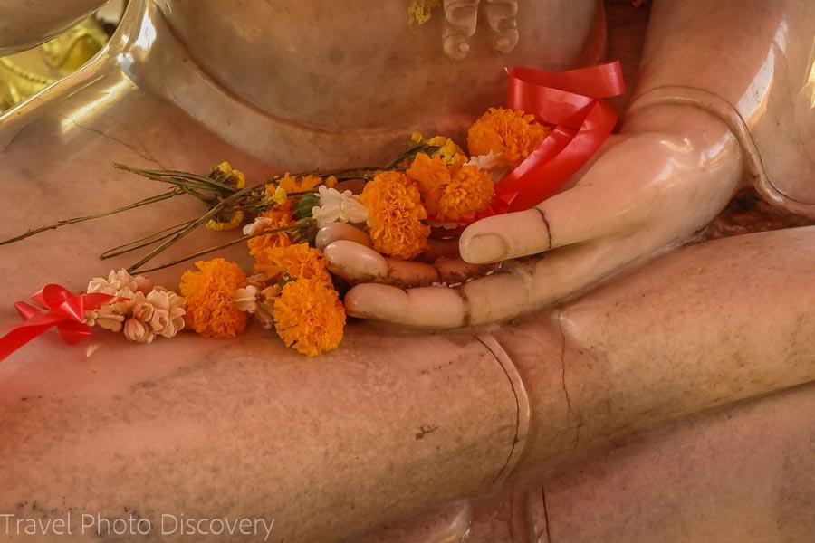 flowers and stone buddha Visiting Wat Phra That Doi Suthep