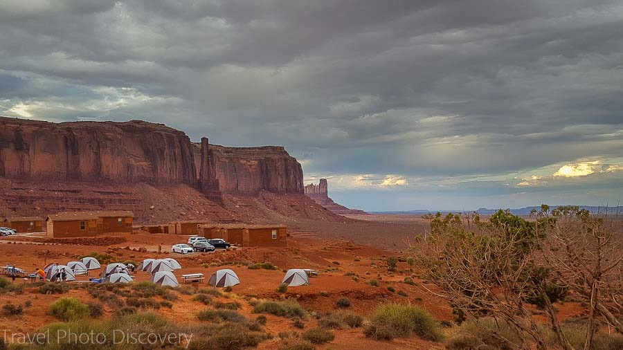Dark clouds during Monsoon season and campsite at Monument Valley