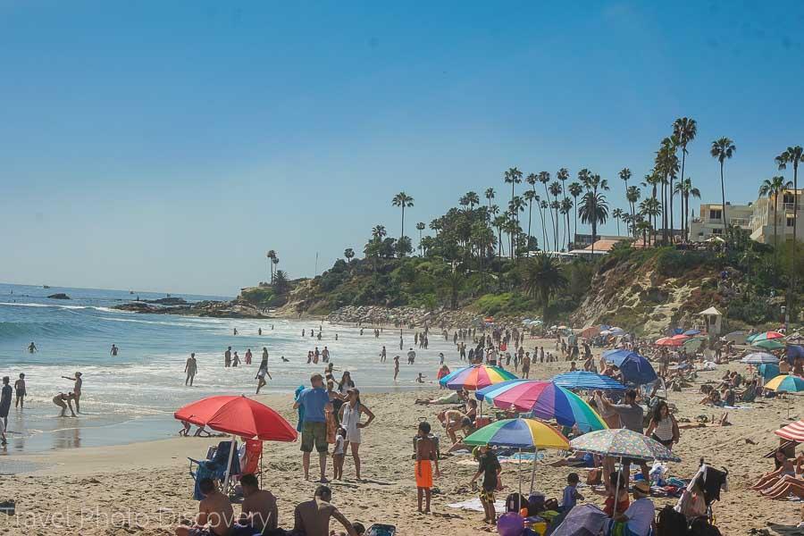 Exploring Laguna Beach coastline and crowded beach