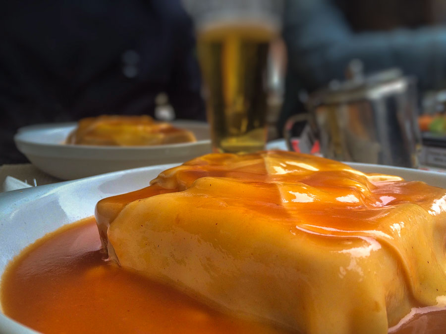 specialty francesinha to try while in Portugal