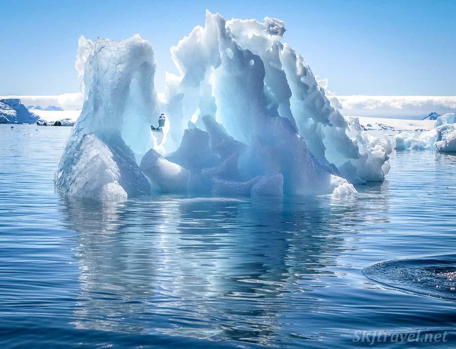 Kayaking around icebergs in Antarctica