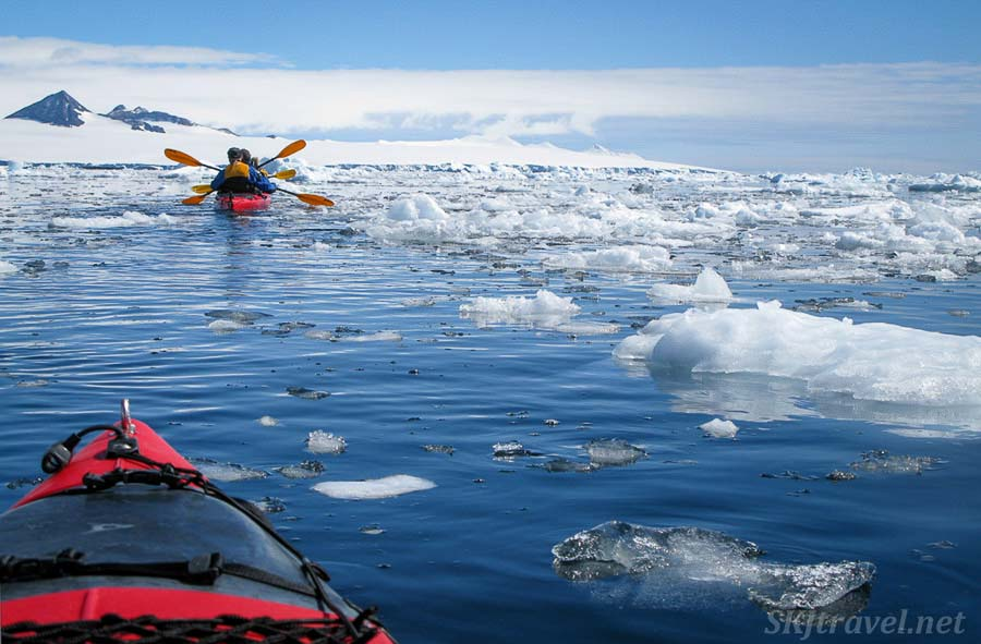 Kayaking around icebergs in Antarctica