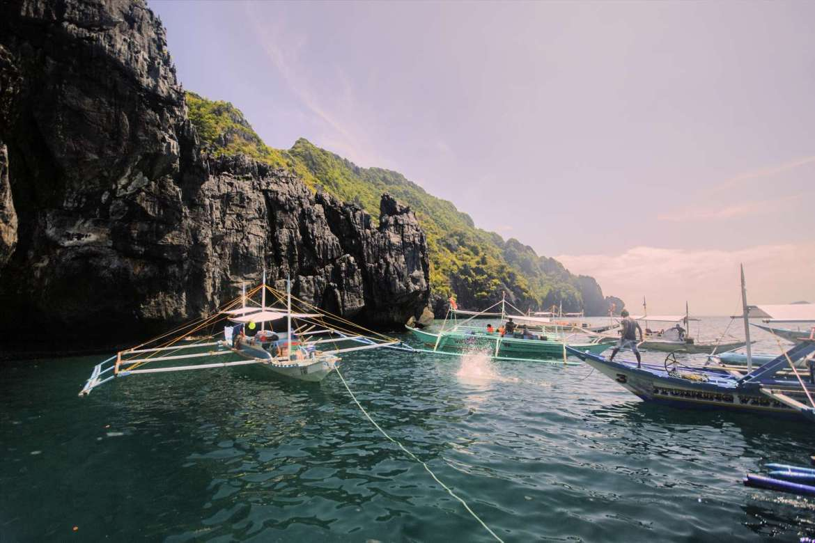 Bancas jockeying for position by the entrance to the Secret Beach, El Nido