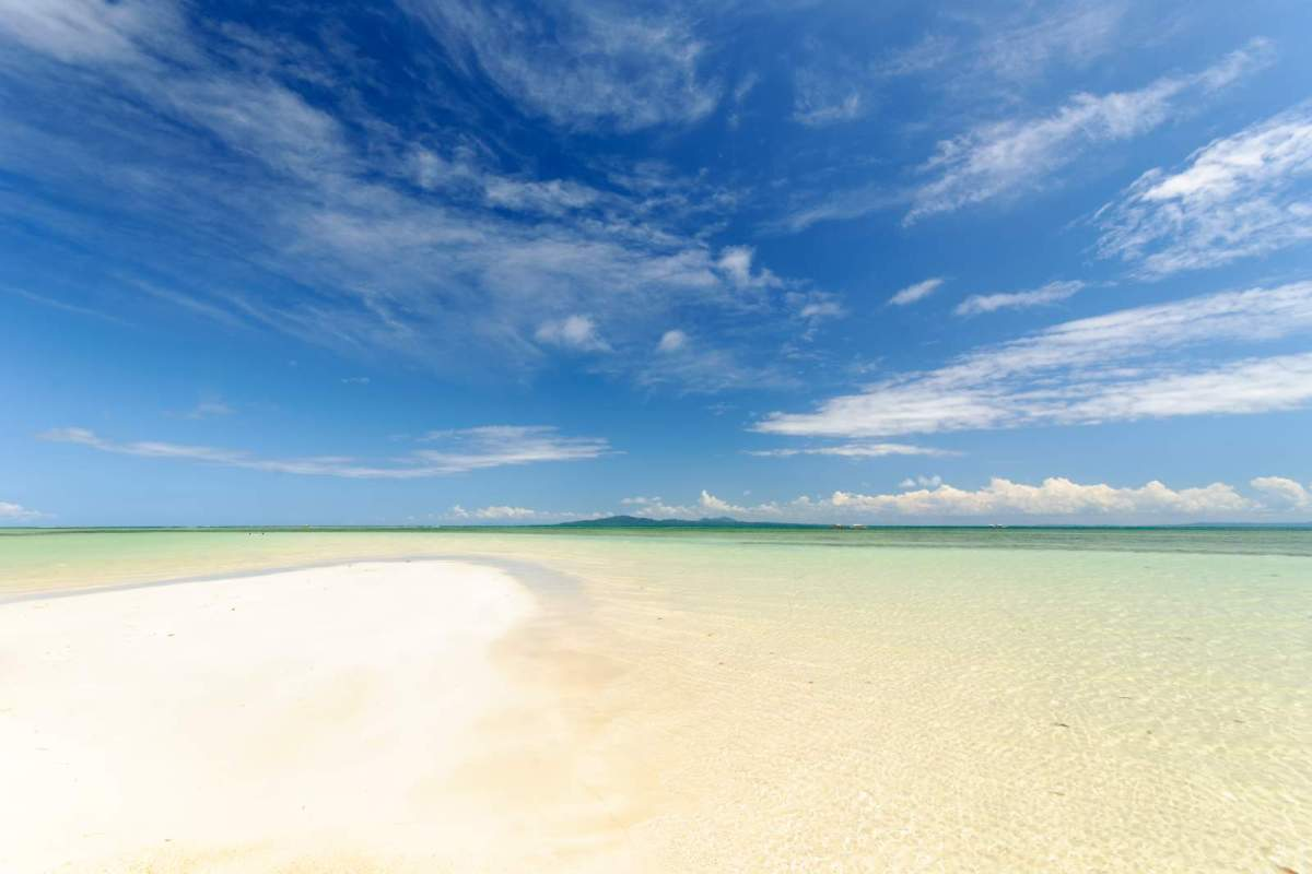 Cagbalete's blue skies, clear waters, white sands