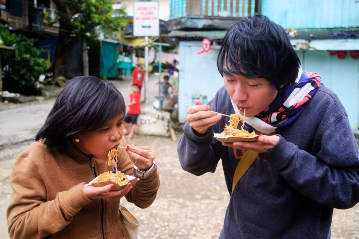 A couple of friends enjoying pancit habhab in Mauban