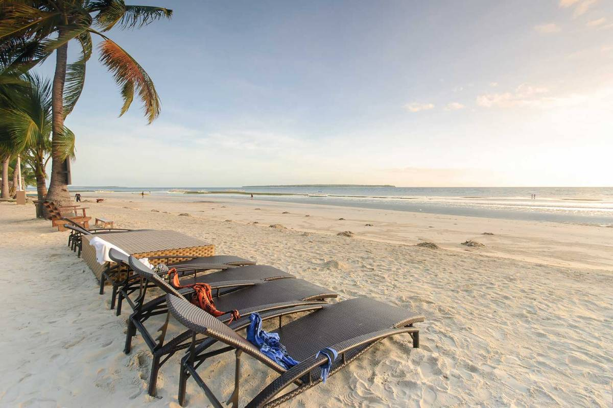 Anika Beach Resort's chaises, Virgin Island on the horizon