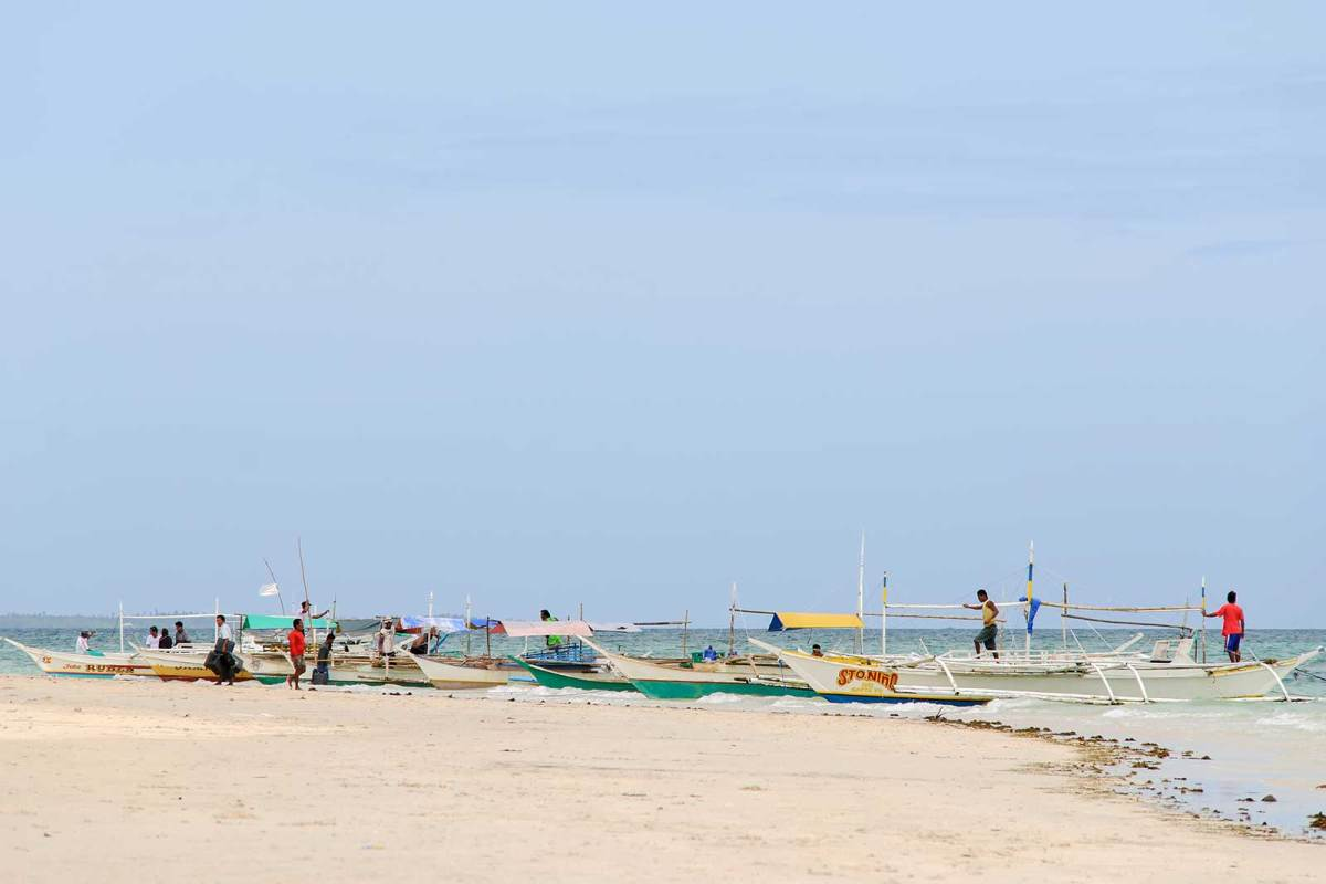 Local fishermen and their bancas, Alice Beach, Bantayan Island