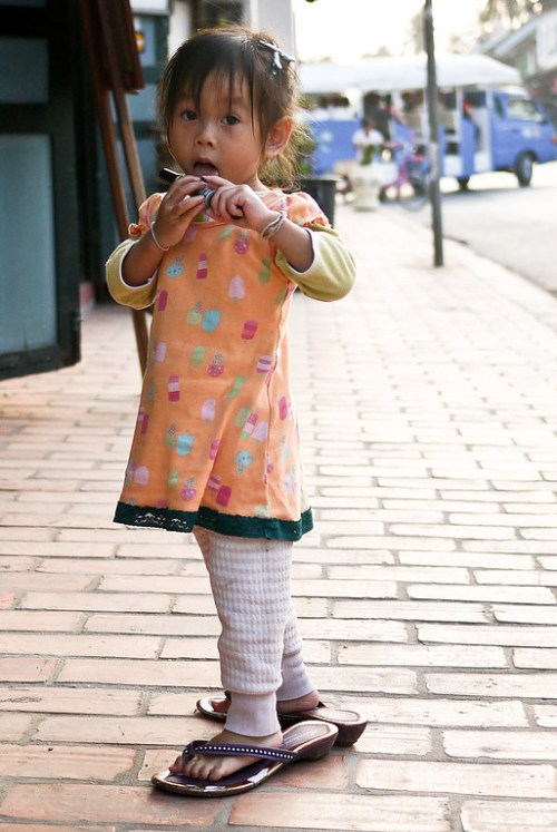 This cute little girl found her mom's high heels! Luang Prabang, Laos