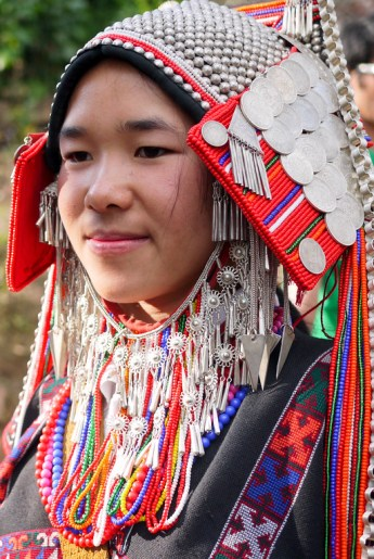 Traditionally dressed Akha villager at the Akha Ama coffee village near Chiang Mai, Thailand.