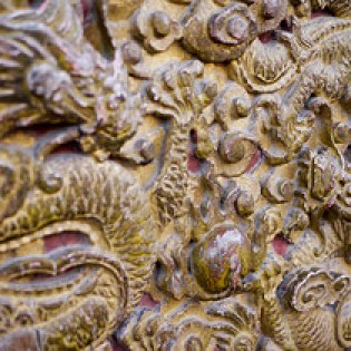 Dragon adornments and carvings on the walls of  the Forbidden City in Beijing, China.