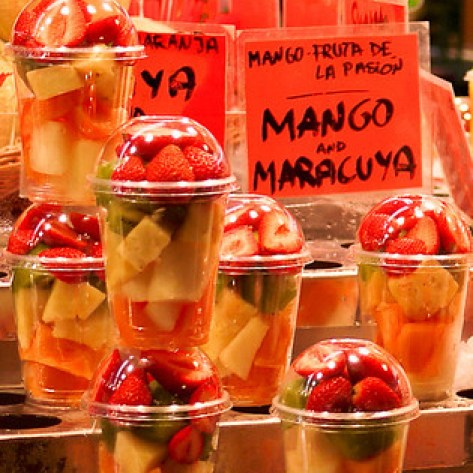 An array of fresh chopped fruit for sale in la Boqueria market in Barcelona, Spain.