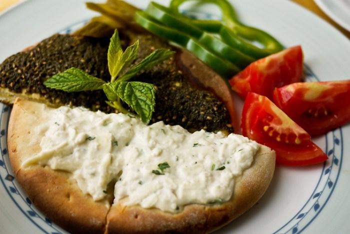 Manakish served with za'atar and fresh veggies.