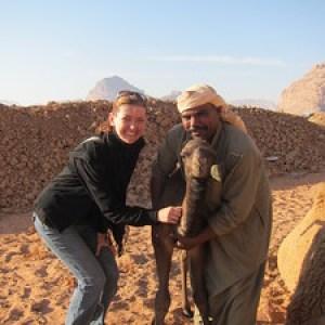 Shabula let's me pet the 4 week old baby camel at Captain's Desert Camp in Wadi Rum, Jordan.