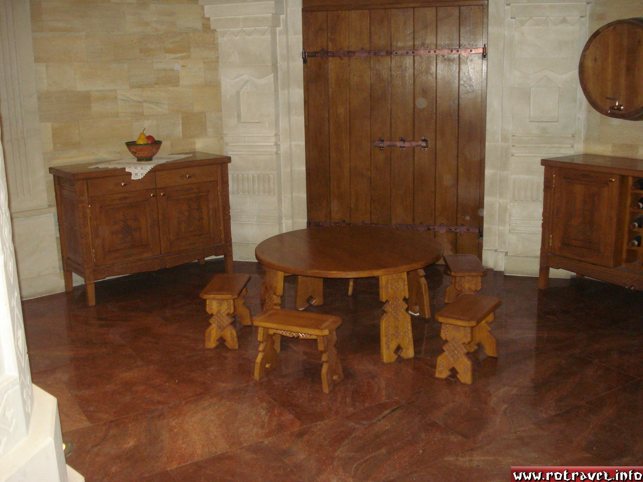 "The guide told us that this small table with small chairs is an imitation of an old Moldavian custom ""La botul calului""(""At the muzzle's horse"").We don't know if we should believe her or not.Anyway, the cart didn't go in the photo :) ."