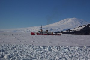 The icebreaker Polar Star clears a path for supply ships.