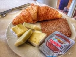 Mr. TSG was enjoying breakfast tat the hotel with a croissant, Nutella, and lots of cheese!